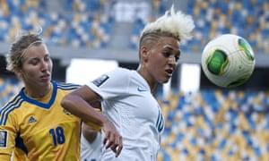 England's Lianne Sanderson, right, battles with the Ukraine's Iryna Vasylyuk during the FIFA Women's World Cup 2015 Qualifier match in Lviv, Ukraine