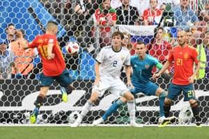 Alba shoots via his thigh.
