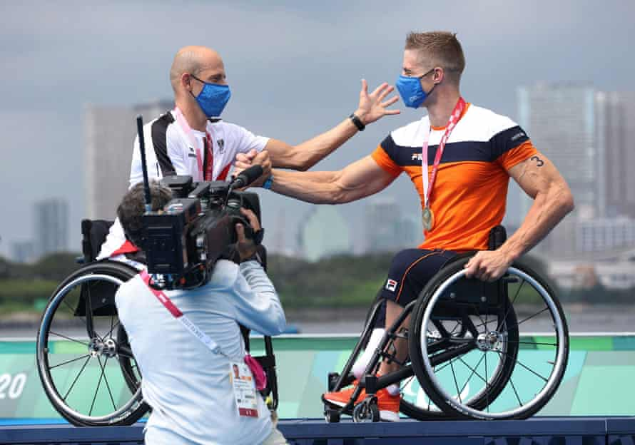 Silver Medallist Florian Brungraber of Austria and gold medallist Jetze Plat of the Netherlands celebrate on the podium.