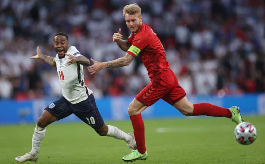 England's Raheem Sterling (left) tries to go past the Denmark captain Simon Kjær during the Euro 2020 semi-final.