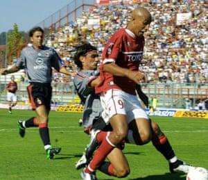 Milan captain Paolo Maldini tackles Bothroyd during Peruga and Milan's Italian Serie A match at Perugia' s Renato Curi stadium in September 2003.