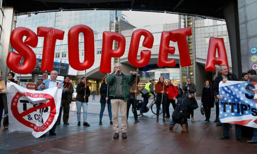 Demonstrators protest against Ceta outside the EU headquarters in Brussels. They claim the deal is bad for Europe's farmers.