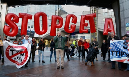 Demonstrators protest against the Canadian-EU trade agreement outside the EU summit in Brussels on 20 October