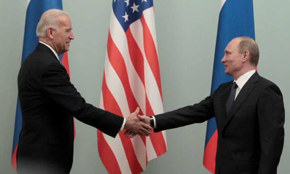 Joe Biden, then the US vice-president, shakes hands with Vladimir Putin during their meeting in Moscow in March 2011.