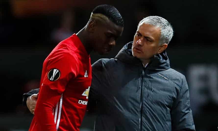 Jose Mourinho helps Paul Pogba