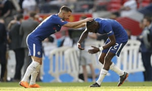 Goalscorer Eden Hazard and man of the match Antonio Rudiger celebrate at the final whistle.