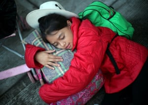 Nancy Alejandra, an eleven-year-old migrant girl from Honduras, sleeps on the roadside as she waits to board a bus to Mexico City from Cordoba, Mexic, 5 November.