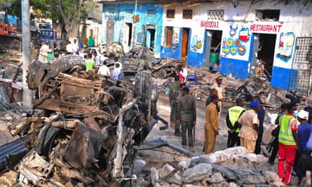 Somali security forces and civilians at the scene of a bomb attack in Mogadishu.