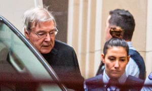 Cardinal George Pell (left) is escorted into the supreme court of Victoria on Thursday morning where he is appealing his prison sentence.