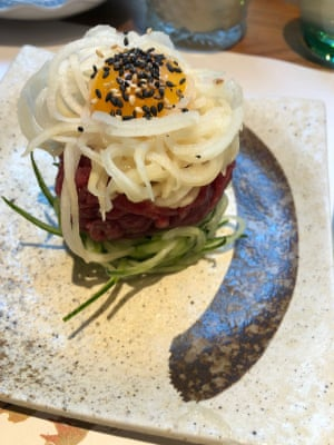 Yuk hwae: raw beef, Asian pear, cucumber and egg yolk at Kimchee in Holborn.
