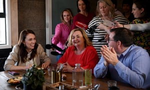 Jacinda Ardern celebrates the election win with colleagues on Sunday.