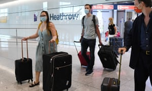 """Passengers arrive at Heathrow Airport in London"""