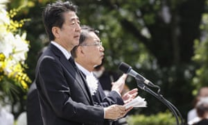 Japan's PM, Shinzo Abe, may be forced to cancel his holiday plans after Tokyo's major called on citizens not to travel due to coronavirus risks.