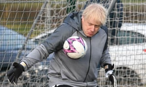 Boris Johnson tries his hand in goal in Cheadle Hume, Cheshire, while on the election campaign trail.