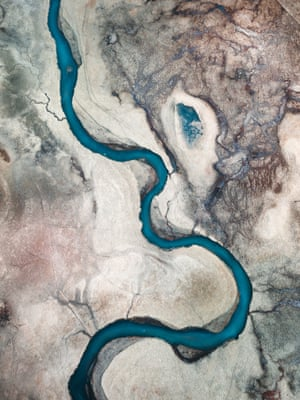 By John Heaney. From the air, the cold, blue rivers in Iceland appear vividly against the volcanic plains.