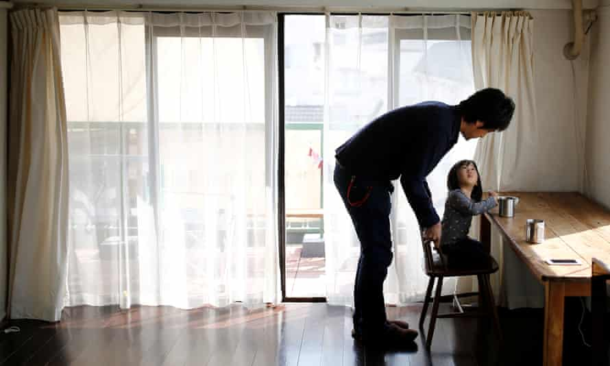 Minimalist Naoki Numahata talks to his two-and-a-half year old daughter Ei in their living-room in Tokyo.