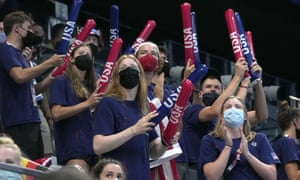 USA swimmers cheer on their teammates at the 2020 Tokyo Olympics