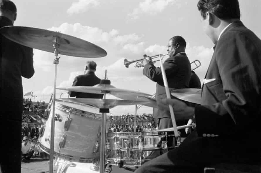 Armstrong and his band play at an outdoor venue (probably in Kenya), late 1960.