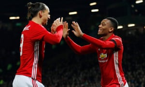 Martial celebrates scoring United's second goal with Ibrahimovic.