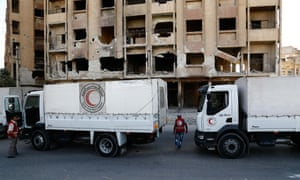 A Syrian Arab Red Crescent aid convoy arrives in Ghouta