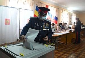 A Cossack casts his ballot in Rostov, Russia