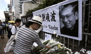 People lay floral tributes to Liu Xiaobo outside the Chinese liaison office in Hong Kong.
