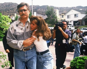 Kim Goldman and her father, Fred, appear before the media three days after the murders in June 1994.
