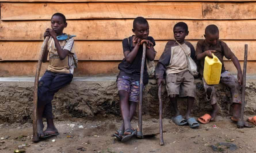 Children rest after a day of work in Kiwanja, eastern Democratic Republic of the Congo