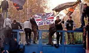 Iranian students stand on the gates of the British embassy in Tehran in November 2011.