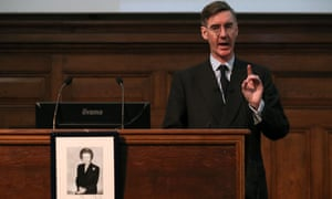Jacob Rees-Mogg speaks during a meeting of the Bruges Group, behind a photograph of former prime minister Margaret Thatcher