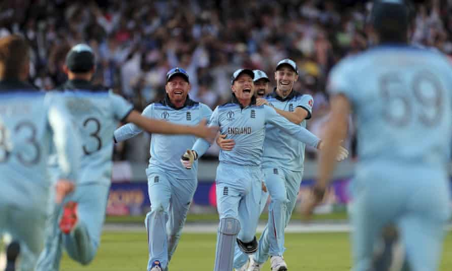 England's Jos Buttler (centre) celebrates with team-mates after the super over dismissal of New Zealand's Martin Guptill.