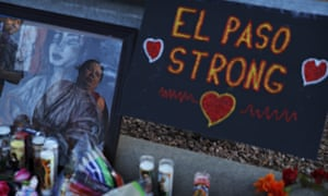 A woman cries as she visits a makeshift memorial at the scene of a mass shooting in El Paso.