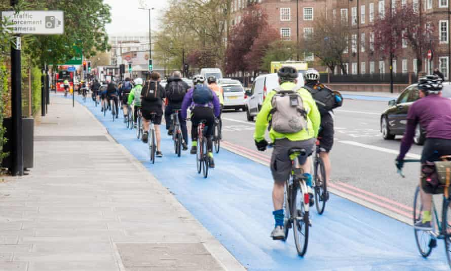 Cyclists using the segregated cycle superhighway at Kennington Oval in south London