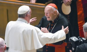 Pope Francis hugs Cardinal Theodore McCarrick at a prayer service on 23 September 2015. McCarrick resigned as cardinal in July.