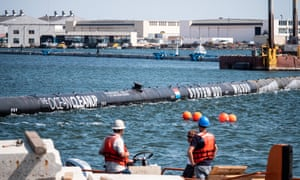 The 600m-long floating barrier, known as System 001