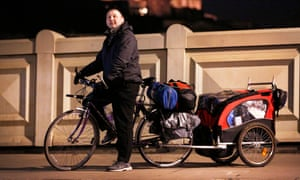 Radik lives on the move carrying a tent, a laptop, even a chair and make shift table in his cycle trailer.