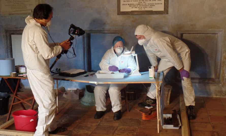 Prof Sue Black (centre) working in the crypt at Wardlaw Mausoleum in Kirkhill, near Inverness