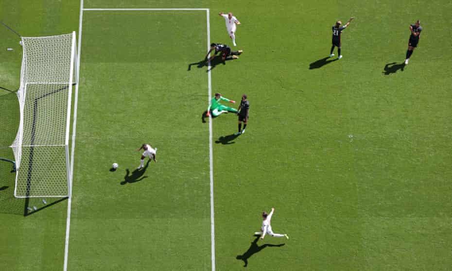 Raheem Sterling celebrates after scoring England's first goal
