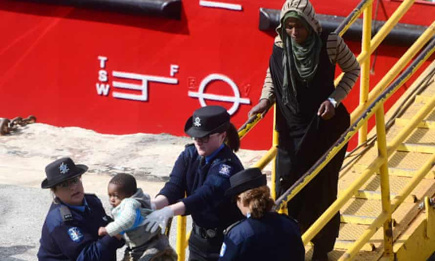 Migrants disembark from the merchant ship El Hiblu 1, after Maltese armed forces took control of the vessel.