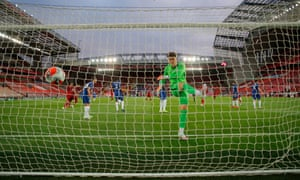 Kepa Arrizabalaga kicks the balls in frustration after Georginio Wijnaldum's goal for Liverpool.