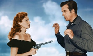 Fleming pulls a gun on John Payne in a publicity shot for The Eagle and the Hawk (1950)