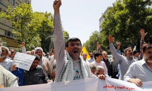Iranian Islamists shout slogans during a protest against allowing women to sporting stadiums earlier in June