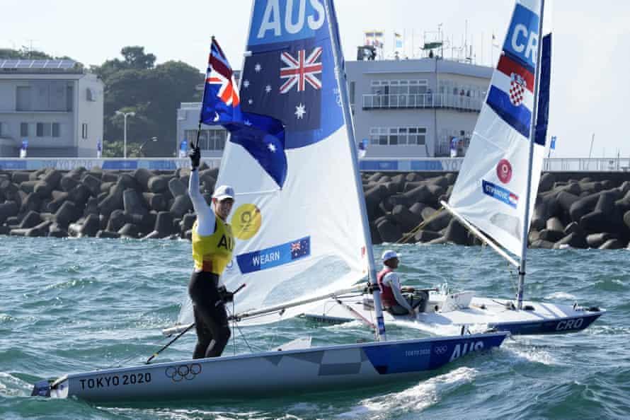 Australia's Matt Wearn celebrates after placing first in the men's laser medal race.