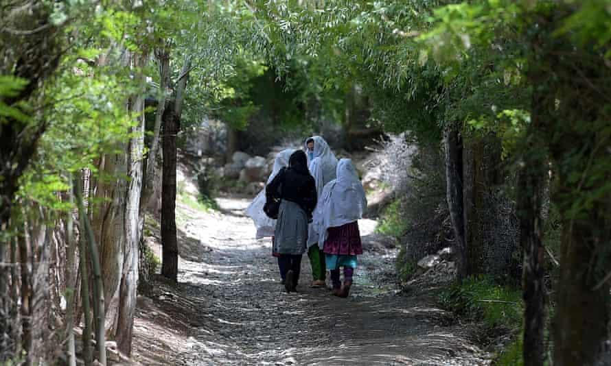 Women walking in rural Pakistan.
