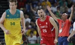 Serbia's Milan Macvan celebrates during the team's win over Australia in a men's semi-final match.