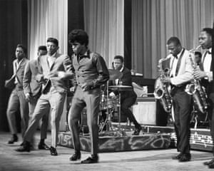 James Brown performs with the Famous Flames at the Apollo Theater in 1964.