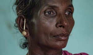 Rasathi, the widow of a farmer, Selvarasy, who took his own life.