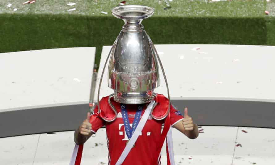 Bayern Munich's player Lucas Hernández celebrates with the Champions League trophy last season.