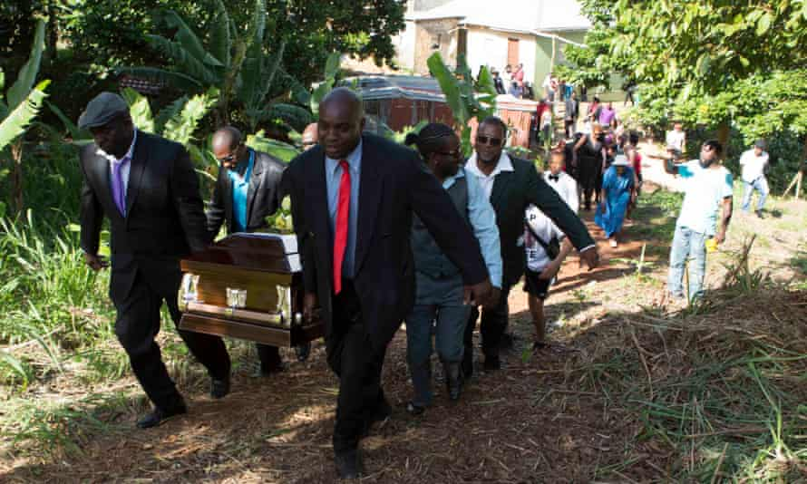 Finding peace: family members carry the coffin of Mzee Mohammed to its final resting place in Mandeville, Jamaica.