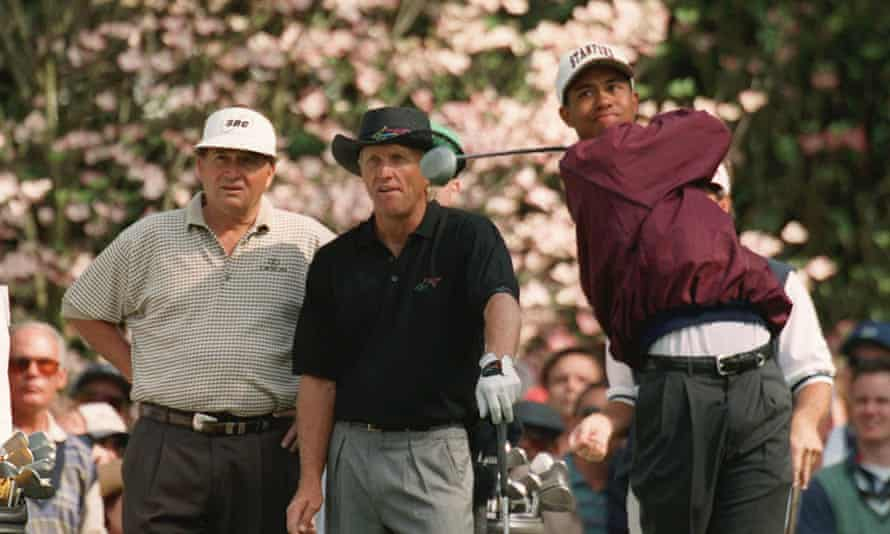 Greg Norman and Ray Floyd watch Tiger Woods practise at Augusta during the 1995 Masters.
